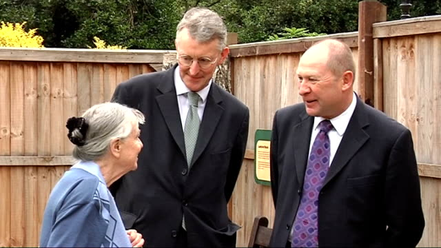 former women's land army members visit replica allotment in st james' park with hilary benn more of benn and harding wandering round allotment with... - hilary benn stock-videos und b-roll-filmmaterial