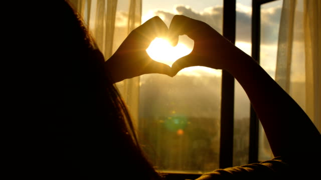 forming heart shape with sunset - segnale video stock e b–roll