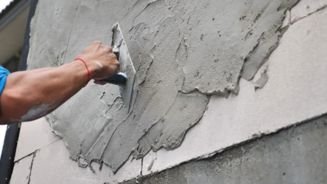 forming of smooth hard surface on walls - cement stock videos & royalty-free footage