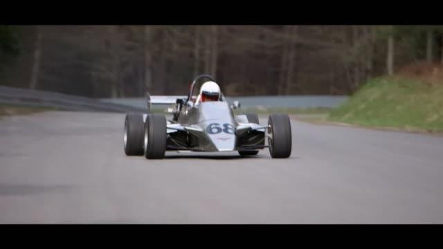 formula 3 car on race circuit - matte image technique stock videos & royalty-free footage