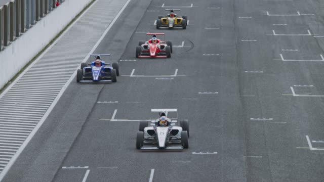 formula car race - competitive sport stock videos & royalty-free footage
