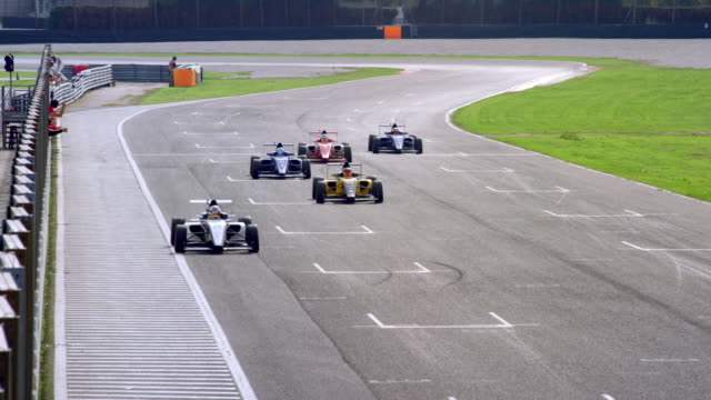 ld formula cars driving across the finish line - rischio video stock e b–roll