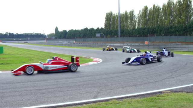 cs formula cars driving through a turn on the race track - professional sportsperson stock videos & royalty-free footage