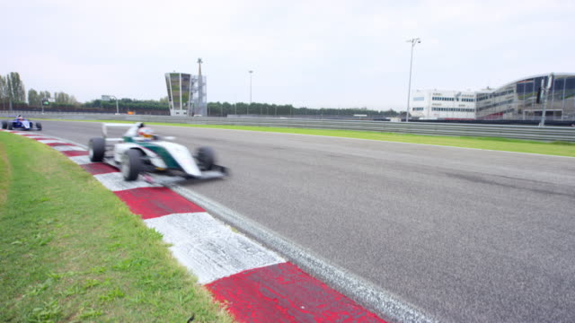 cs formula cars in a race passing by - grand prix motor racing stock videos & royalty-free footage