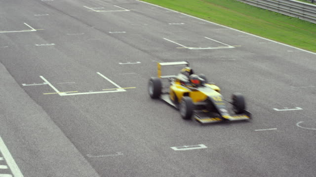 ld formula cars racing by on the track - championships stock videos & royalty-free footage