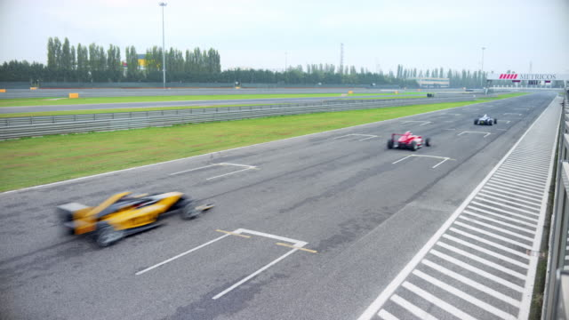 formula cars speeding on the race track - crash helmet stock videos & royalty-free footage
