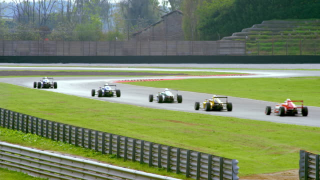 ld formula cars speeding through a chicane in competition - efficiency stock videos & royalty-free footage