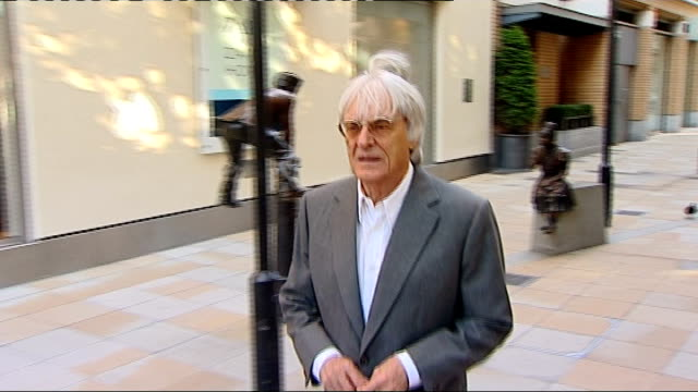 formula one: bahrain grand prix in doubt; t07061123 england: london: bernie ecclestone along - bernie ecclestone stock videos & royalty-free footage