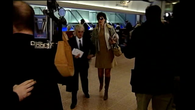 formula one: battle for ownership rights; england: london: heathrow airport: int **flashlight photography** bernie ecclestone photographed by press... - bernie ecclestone stock videos & royalty-free footage