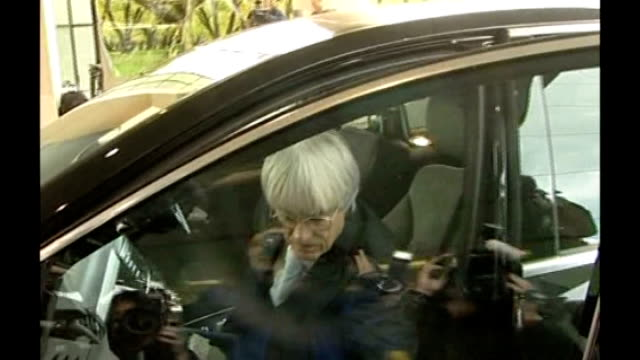 formula one ferrari goes to court over plans to cap team budgets england heathrow airport ext bernie ecclestone from car to meeting with press around - bernie ecclestone stock videos & royalty-free footage