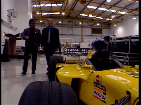Formula One Grand Prix Car changes ITN Int Eddie Jordan intvw as along with Rees beside Jordan car in pit garage / can't see how it complies with the...