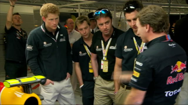 Formula One Prince Harry attends British Grand Prix INT More shots of Harry being shown Red Bull car and chatting to Red Bull mechanics / Harry...
