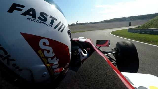formula one racing car driving on a racetrack - automobile da corsa video stock e b–roll
