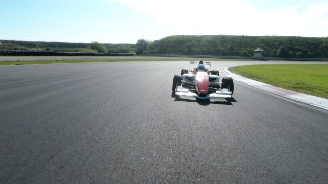 formula one racing car driving on a racetrack - pursuit sports competition format stock videos and b-roll footage