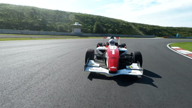 formula one racing car driving on a racetrack - strength stock videos & royalty-free footage