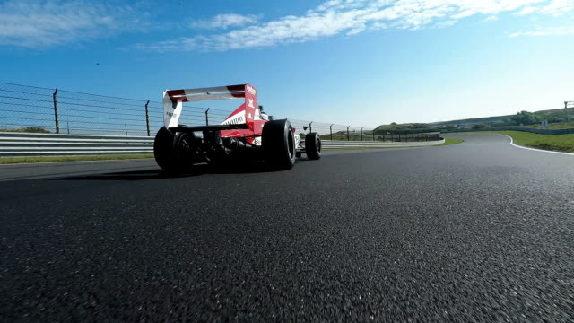 formula one racing car driving on a racetrack - efficiency stock videos and b-roll footage