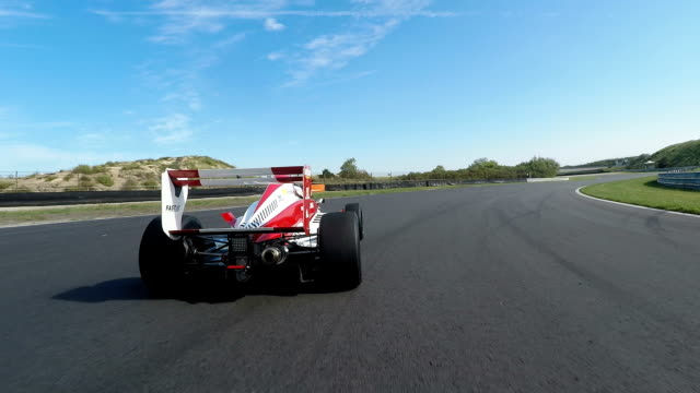 formula one racing car driving on a racetrack - chasing stock videos & royalty-free footage