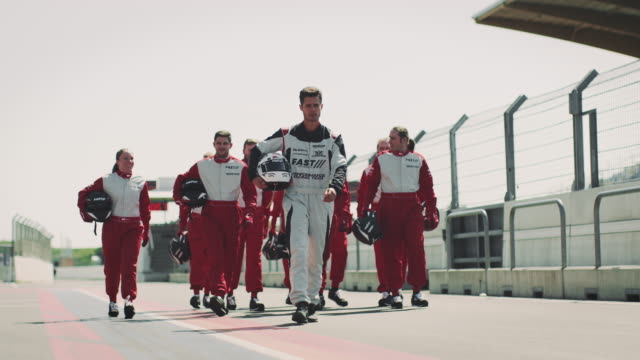 formula one racing team walking on sports track - sports race stock videos & royalty-free footage