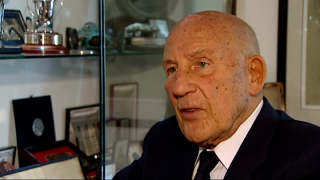 formula one stirling moss interview various setups of moss as talking reporter through medals and trophies on display/ various close shots of medlas... - display cabinet stock videos & royalty-free footage
