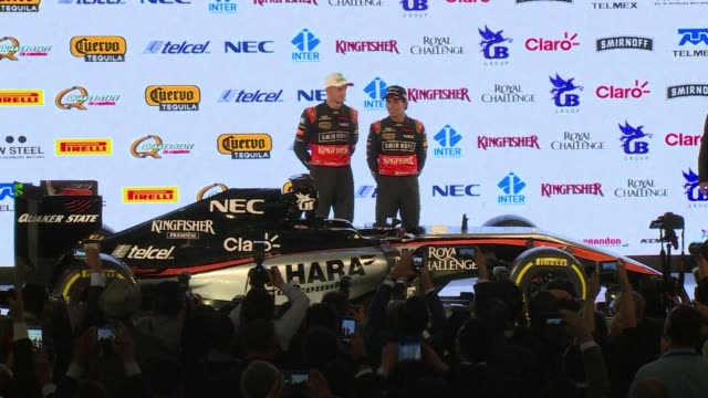 vídeos de stock, filmes e b-roll de formula one team force indias drivers germanys nico hulkenberg and mexican sergio perez pulled back the covers on the car they hope will bring them... - méxico central
