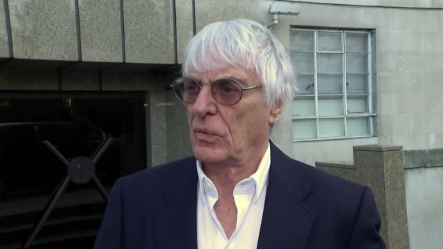 formula one: threat of job losses if british grand prix is lost; england: london: ext reporter talking to bernie ecclestone bernie ecclestone... - bernie ecclestone stock videos & royalty-free footage