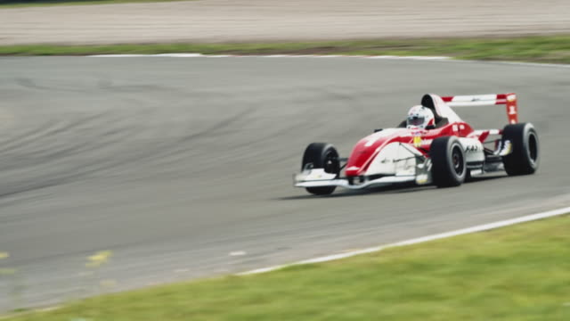 formular one racing car driving on a racetrack - motorsport stock videos & royalty-free footage