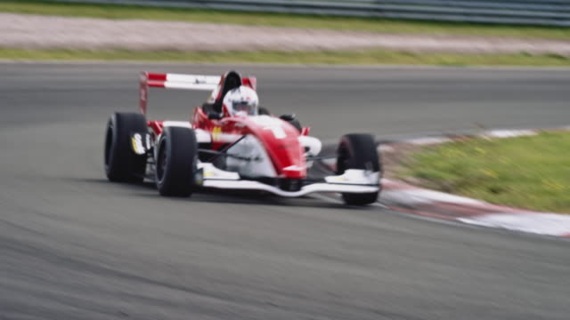 formular one racing car driving on a racetrack - contestant stock videos & royalty-free footage