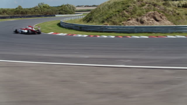 formular one racing car driving on a racetrack - pursuit sports competition format stock videos and b-roll footage