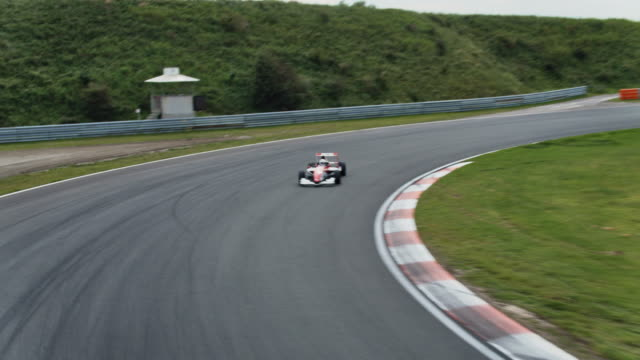 formular one racing car driving on a racetrack - racing car stock videos & royalty-free footage