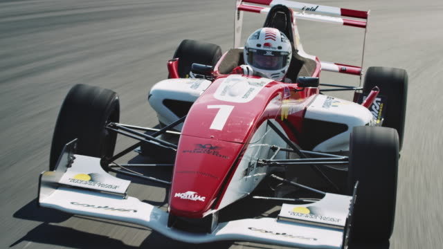 formular one racing car driving on a racetrack - sports track stock videos & royalty-free footage