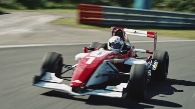 formular one racing car driving on a racetrack - formula one racing stock videos & royalty-free footage
