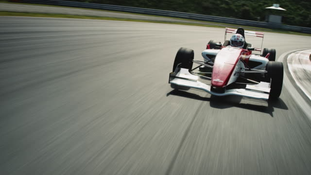 formular one racing car driving on a racetrack - pursuit concept video stock e b–roll