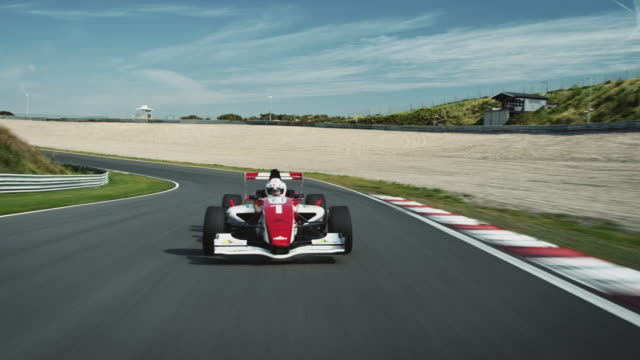 formular one racing car driving on a racetrack - strength stock videos & royalty-free footage