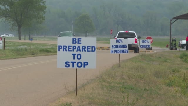 wreg forrest city ar us warning signs along road leading to correctional facility after covid19 outbreak in federal prison cdc investigates the... - federal prison building stock videos & royalty-free footage