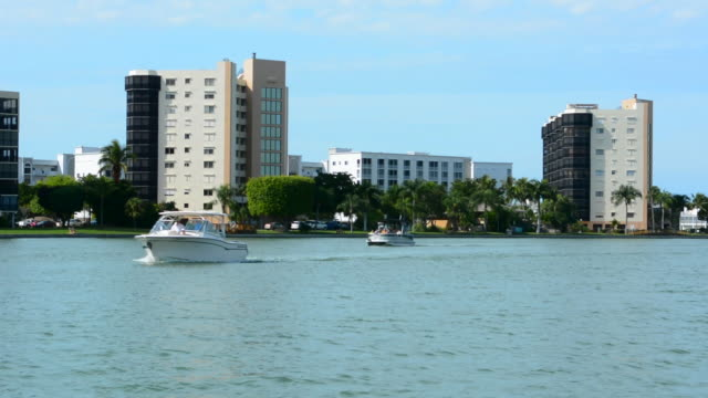 fort myers beach, florida intercostal waterway of condos and boats taken from a moving pontoon boat - fort myers beach stock videos & royalty-free footage