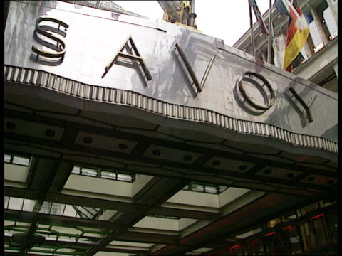 forte sell offs england ms savoy entrance with traffic london cla sign above 'savoy' cms doorway calling for taxi tx itn int cms bell in counter rung... - page stock-videos und b-roll-filmmaterial