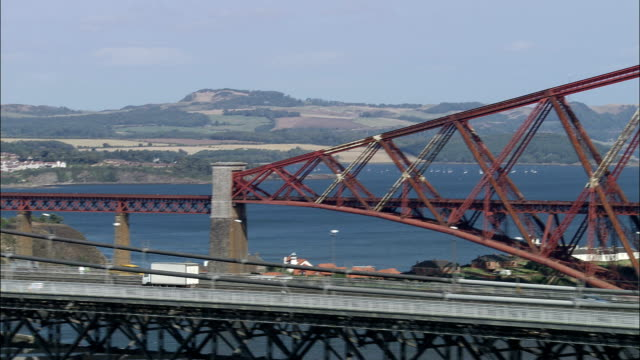 forth bridge  - aerial view - scotland, united kingdom - firth of forth stock videos & royalty-free footage