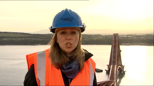 Forth Bridge painting job nears its end Forth Bridge structure with Firth of Forth and mountains in distance Forth Bridge with coastal town in...