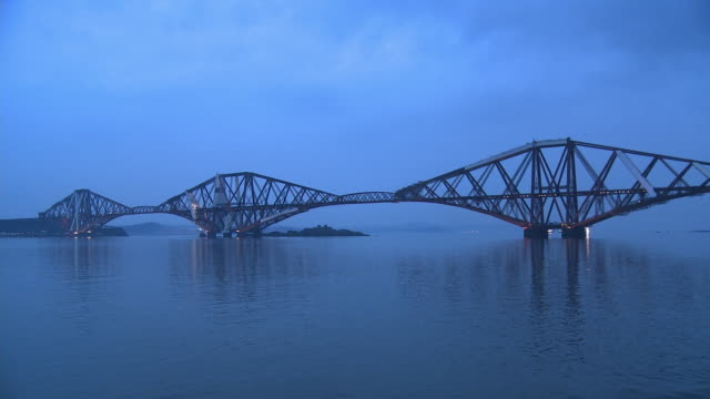 ws, forth rail bridge at dusk, edinburgh, scotland, united kingdom - cantilever stock videos & royalty-free footage