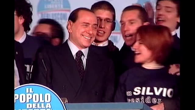 forthcoming national elections overshadowed by alleged corruption and economic instability; rome: int silvio berlusconi at rally podium as supporters... - equilibrio video stock e b–roll