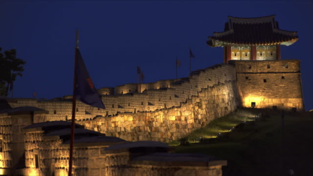 fortified wall at suwon hwaseong fortress (unesco heritage site) at night - hwaseong palace stock videos and b-roll footage