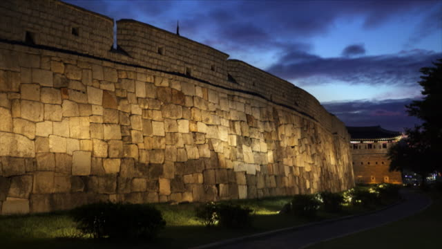fortified wall at suwon hwaseong fortress (unesco heritage site) at sunset - suwon stock videos and b-roll footage