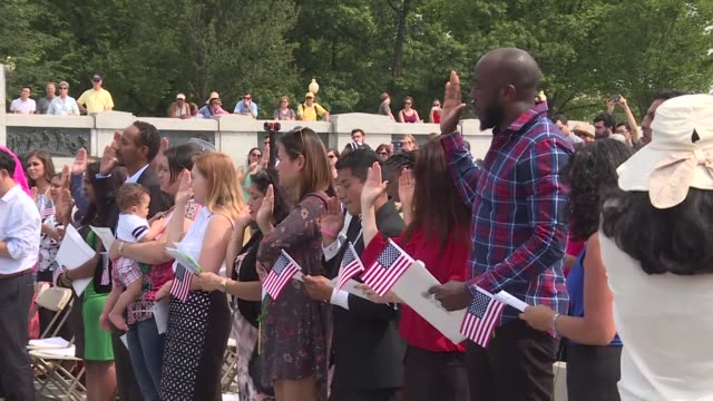 forty people from various countries take the oath of citizenship during a ceremony at the memorial to the second world war in the us capital - citizenship stock videos & royalty-free footage