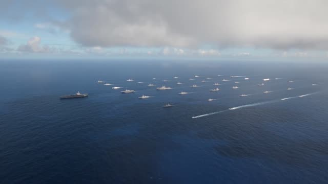 stockvideo's en b-roll-footage met forty-two ships and submarines representing 15 international partner nations steam in a close formation during rim of the pacific exercise 2014.... - pacific ocean