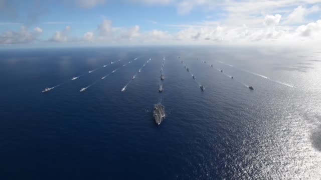 fortytwo ships and submarines representing 15 international partner nations steam in a close formation during rim of the pacific exercise 2014... - 海軍点の映像素材/bロール
