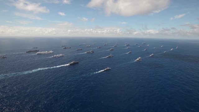 forty-two ships and submarines representing 15 international partner nations steam in a close formation during rim of the pacific exercise 2014.... - at the edge of stock videos & royalty-free footage