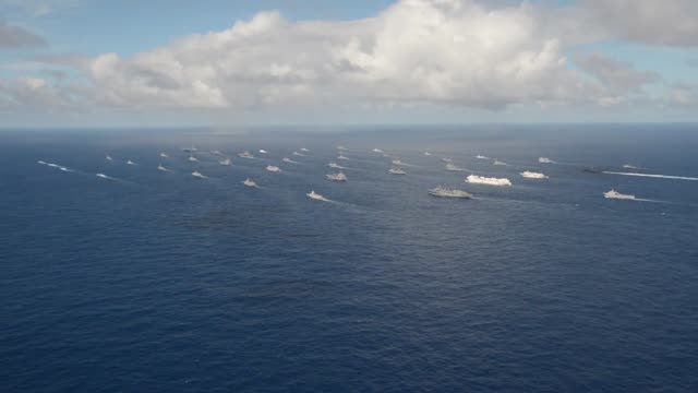forty-two ships and submarines representing 15 international partner nations steam in a close formation during rim of the pacific exercise 2014.... - us navy stock videos & royalty-free footage