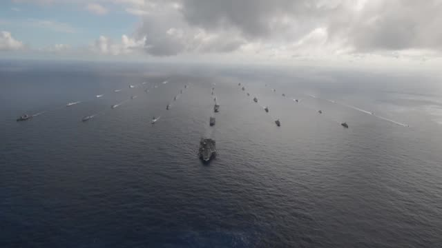 Fortytwo ships and submarines representing 15 international partner nations steam in a close formation during Rim of the Pacific Exercise 2014...