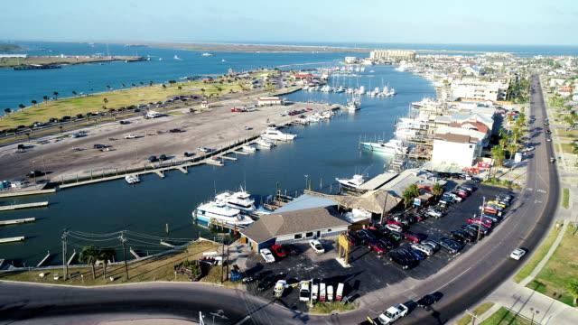 forward aerial drone above padre island port aransas , texas gulf coast - corpus christi texas stock videos & royalty-free footage