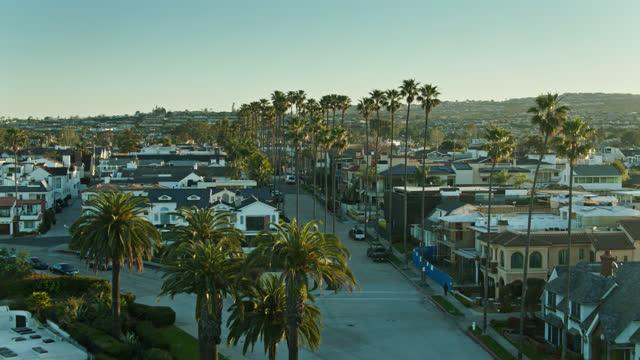 forward aerial shot revealing wider corona del mar neighborhood - urban road stock videos & royalty-free footage